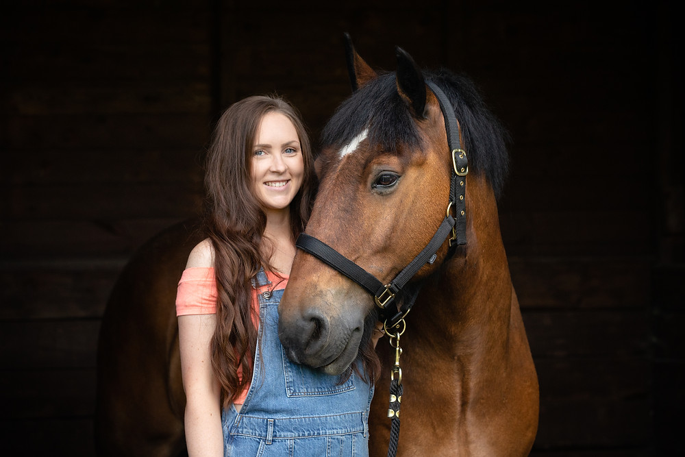 Children's book author Lois Kingscott smiling with her horse Dave