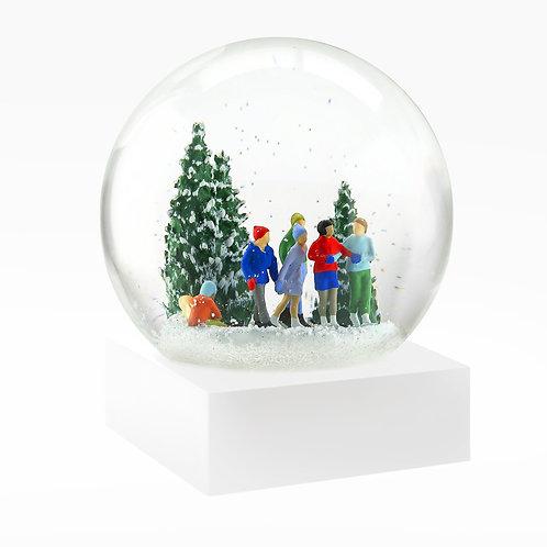 Ice skaters snow globe