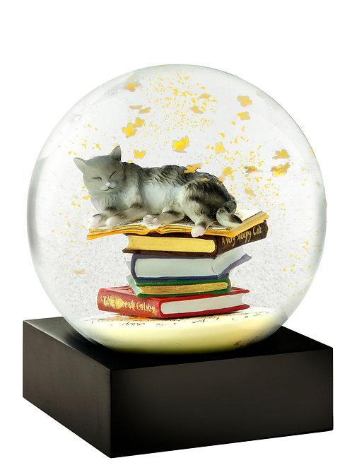 Cats on books white snow globe