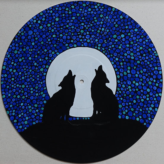 Two wolves on vinyl record