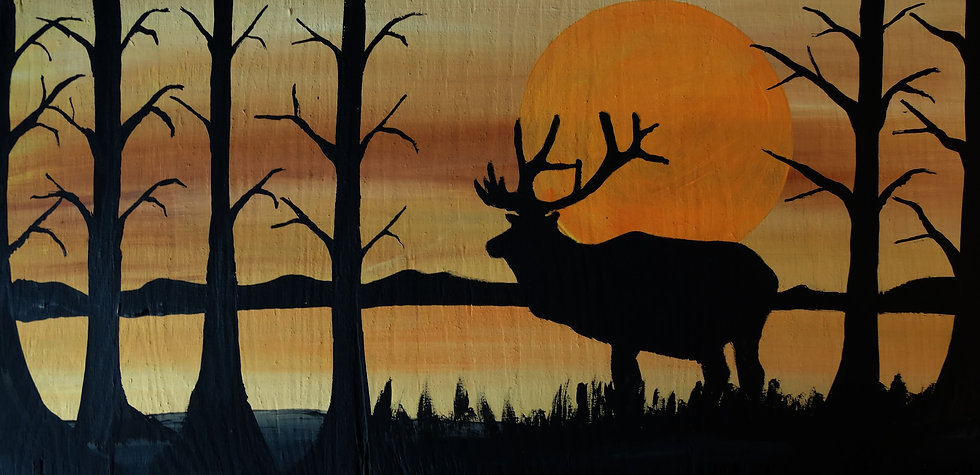 Silhouette caribou on wood
