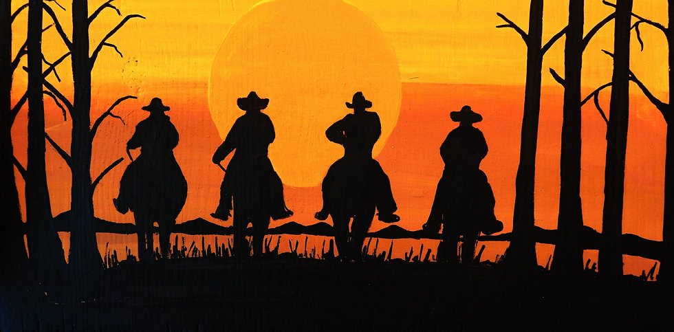 Cowboys in sunset