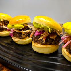 Micro Burgers on Brioche with Cajun Aioli, Guacamole, Pickled Cabbage, Crispy Onion Frites