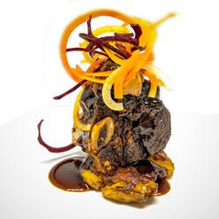 Red Wine Date Braised Short Ribs, Herb Garlic Crispy Potato, Sautéed King Mushrooms, Au Jus, Heirloom Carrot Slaw