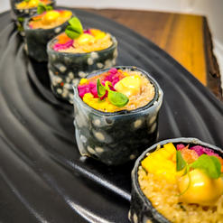 Sesame Nori Wrapped Kimchi Rice Paper Roll with Vermicelli and Pickled Vegetables Topped with Sriracha Aioli