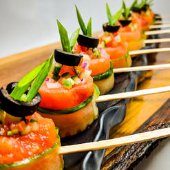 Balsamic Infused Watermelon Wrapped with Cucumber Ribbon Topped with Greek Salsa