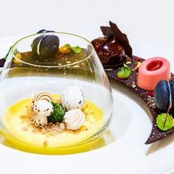 Lemon Meringue with Smokey Charcoal Macaron, Mirror Glazed Chocolate Dome, Raspberry Panna Cotta