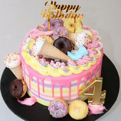 Vanilla Rainbow Donut Drip Cake
