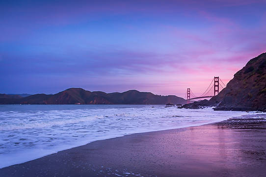 Sunrise over the Golden Gate Bridge and Baker Beach