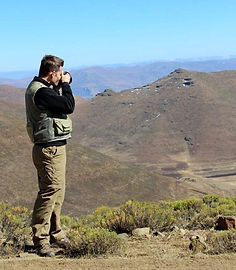 Aaron taking photos of the mountains in Lesotho, Africa