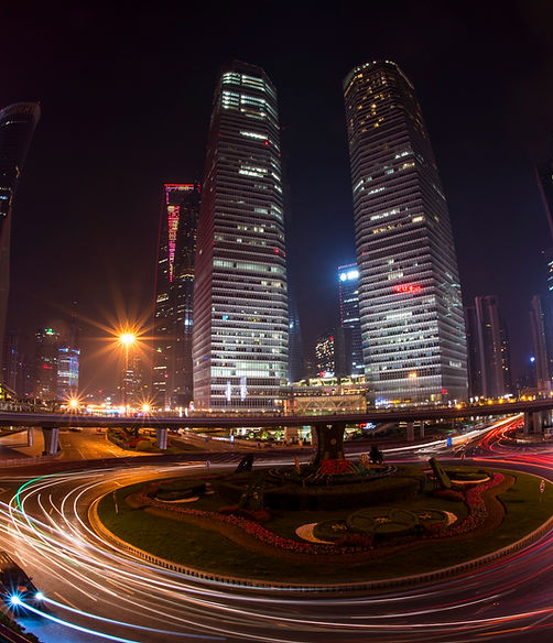A long exposure captures lights of skyscrapers and the night time activities of Shanghai, China.
