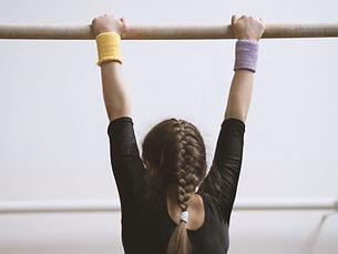 Gymnast on a Wooden Bar