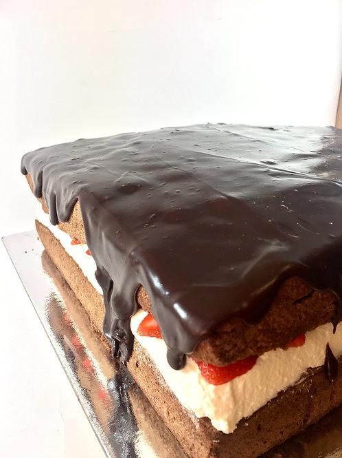 Large square chocolate sponge with fresh strawberries, cream& ganache