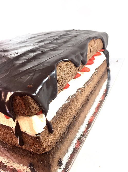 Gluten free large chocolate sponge with fresh cream and strawberries