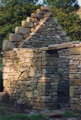 The dry stone walls are 2 ft thick at the base and it is 23 ft high at its highest point.