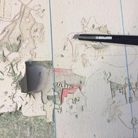 Excavation des dessins à travers les couches de peinture
