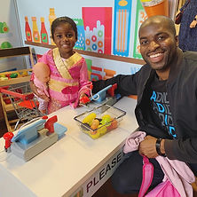 Father and daughter play in the supermarket at Little City mobile play centre
