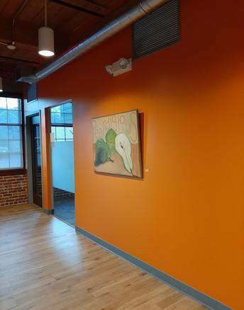 Workbar 2020 2nd Fl Orange wall back.jpg