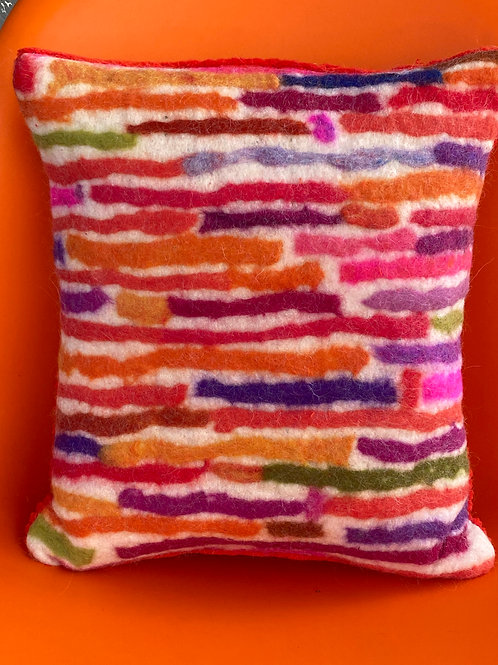Stripes pillow--reds and oranges by Cogswool