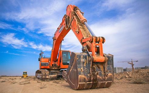 low-angle-photography-of-orange-excavato