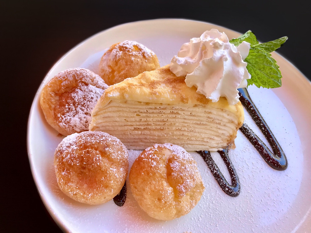 Cake. Dessert. Crepe. Custard. Whipped cream. Food. Cream Puff. Restaurant.