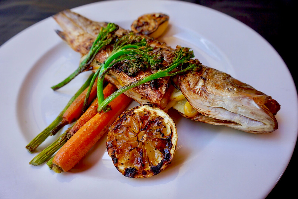 Branzini. Fish. Grill. Restaurant. Dish. Vegetables. Broccolini. Food. Lemon.