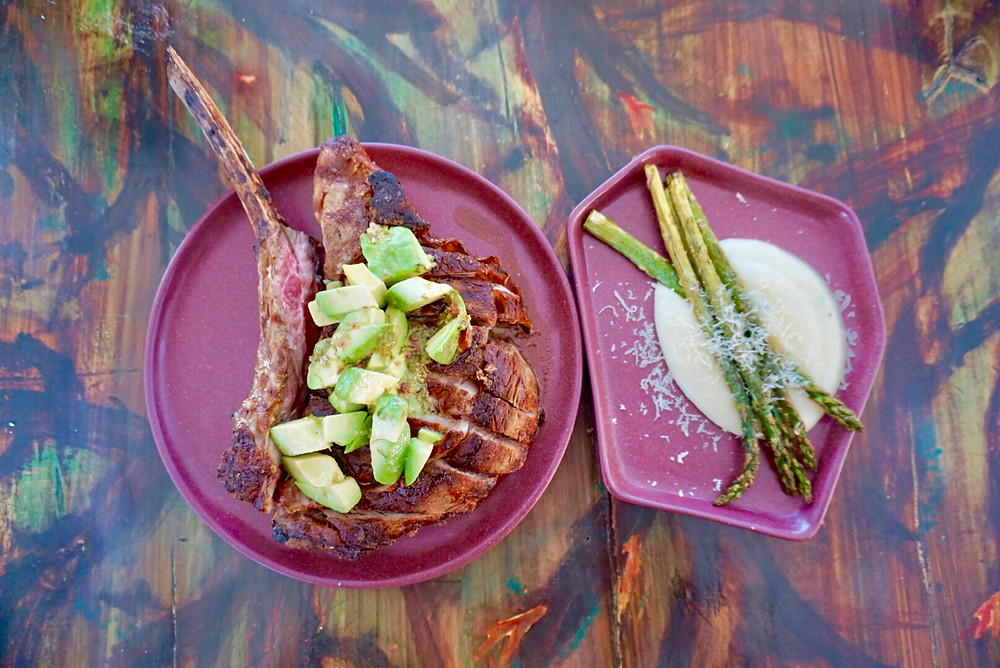 FUEGO COCINA DEL VALLE. FOOD. FARM TO TABLE. BAJA WINE COUNTRY. MEXICO. RESTAURANT. PLATE. FARM TO TABLE. TOM HAWK. STEAK. ASPARAGUS. AVOCADO. DELICIOUS. DINNER. MEAT. VEGETABLES.