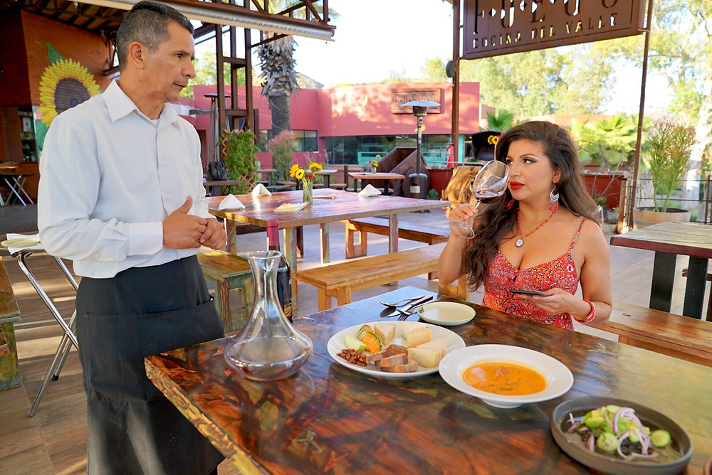 FUEGO COCINA DEL VALLE. BAR AND GRILL. DINING. RESTAURANT. TASTING. HOSPITALITY. FOOD. MEXICO. BAJA WINE COUNTRY. MAN. WOMAN. ROSE BUD.