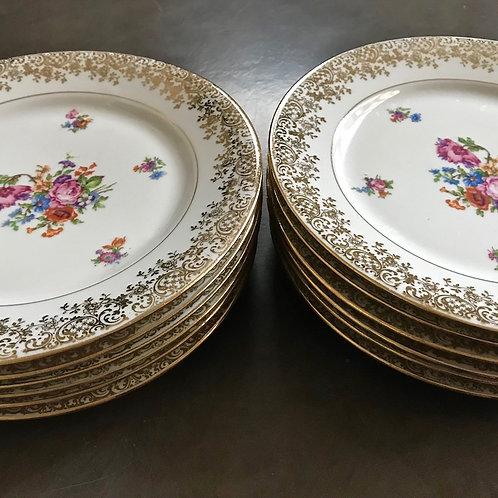 Assiettes porcelaine de Limoges à fleurs et frise dorée