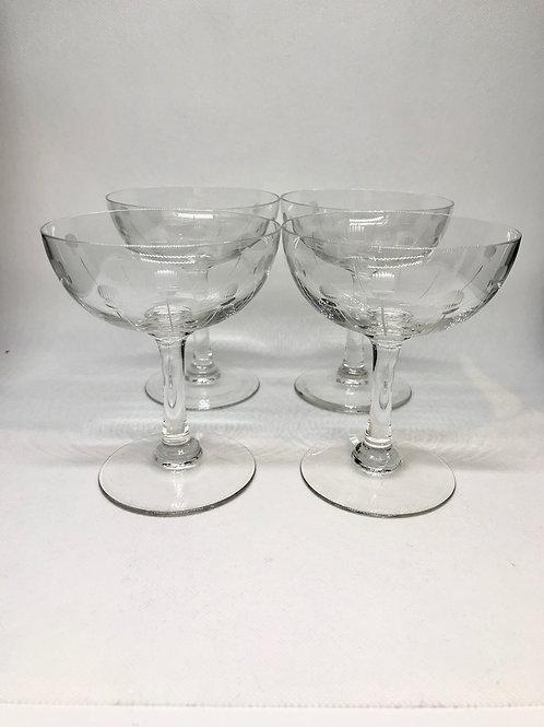 Coupes à champagne en cristal gravé