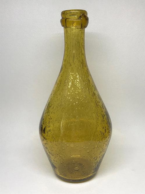 Bouteille vintage en verre soufflé et bullé ocre