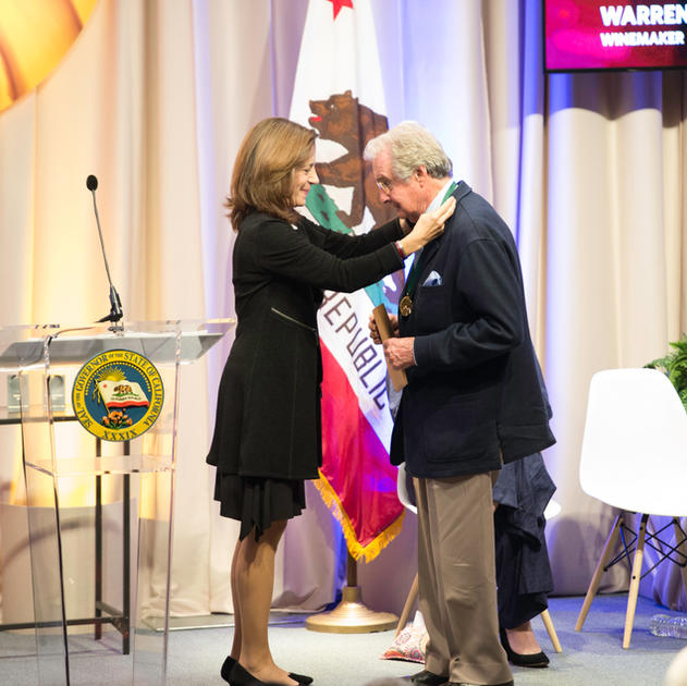 """Warren Winiarski receiving """"Spirit of California"""" medal presented by Governor Edmund G. Brown Jr. and First Lady Anne Gust Brown at an official state induction ceremony into the California Hall of Fame for the 11th class held on December 5th, 2017 at the California Museum"""