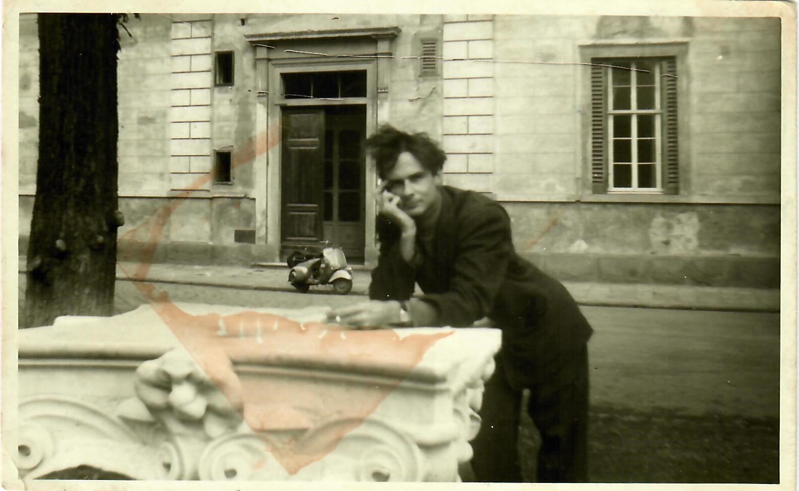 "#18 Piazzale Donatello, 1953, with his Itallian ""Limo"", a Vespa, in background"