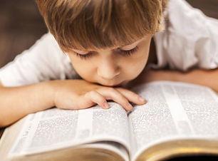 Child-reading-bible-730x400.jpg