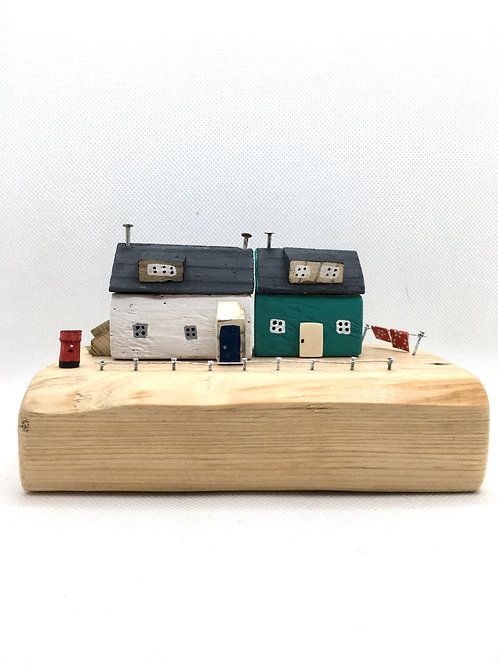 Double seaside cottage with postbox made from local driftwood