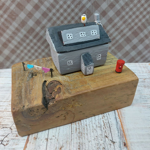 Seaside cottage with seagull made from local driftwood