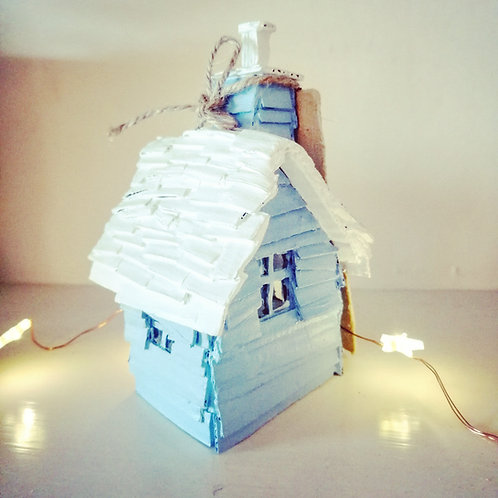 Little blue and white handcrafted cardboard houses
