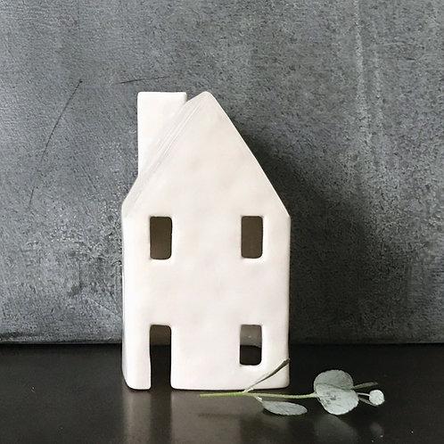 Small white tea light house