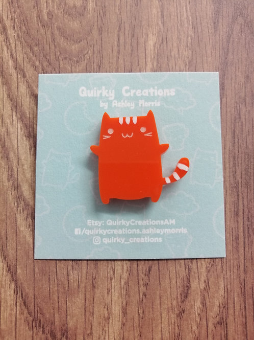 Orange cat brooch