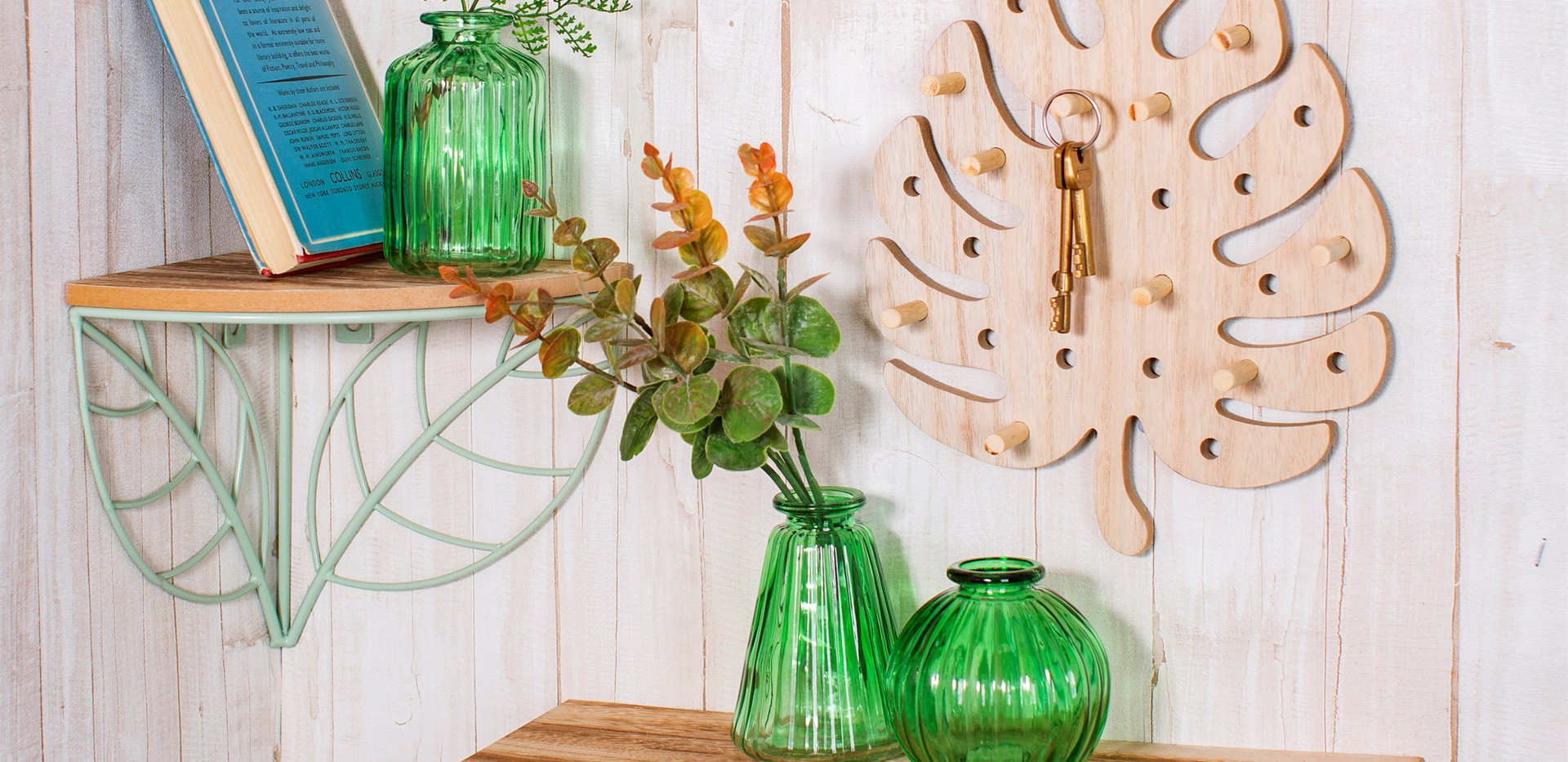 Set of 3 green glass vases