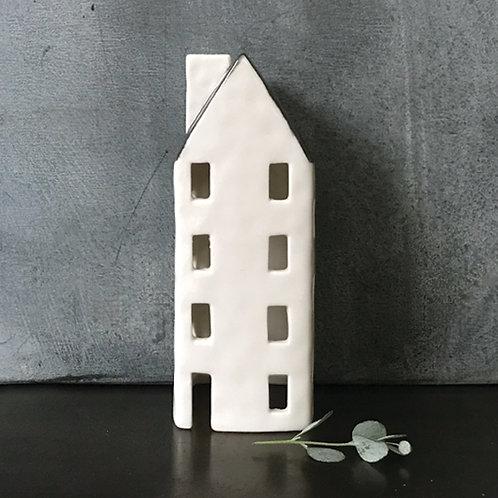 Tall teal light house