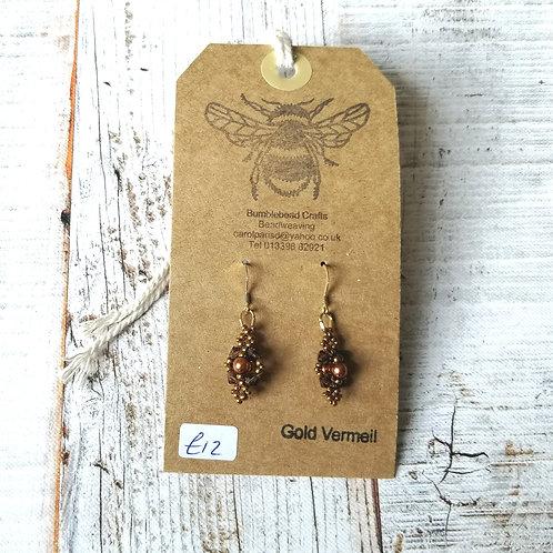 Copper colour beaded drop earrings