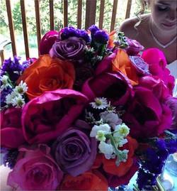 Kansas Peonies with Orange Roses