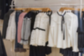 Women clothes on racks in a store in Lon