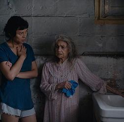 Olivia talks to Olga cleaning dirty sink