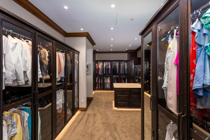 Epic Custom Closet with Glass Front Cabinets