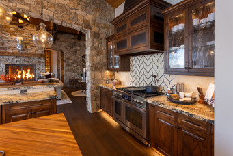 Chef's Kitchen Complete with Dacor Appliances, Multiple Ovens & Dishwashers, and a Butcher Block Center Island