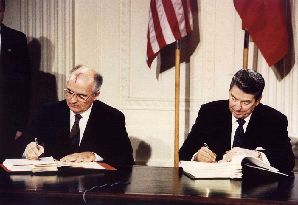 U.S. President Ronald Reagan and Soviet General Secretary Mikhail Gorbachev signing the INF Treaty