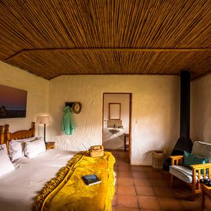 Kliphuis bedroom with bathroom view.jpg