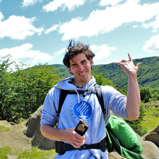 """A happy hiker throws up a """"Hang Loose"""" sign while posing on the trail in Patagonia"""